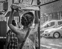 Rainy Day (John St John Photography) Tags: streetphotography candidphotography woman rain raining rainstorm shelter taxi cab urban rainfall droplets lexingtonavenue newyorkcity newyork blackandwhite blackwhite bw monotone outdoor