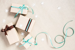 Holiday background with four gift boxes (Olga_Z1982) Tags: christmas holiday gift background invite present decor greeting box bow brown turquoise paper beige ribbon festive kraft wrapped decoration snowflake