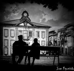 Watching the Time Go by (Juan Figueirido) Tags: chaves portugal time tiempo oldage couple pareja clock reloj bench banco blackandwhite blancoynegro fz150