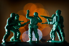 Caught!! (steved_np3) Tags: caught war fire bokeh fight fighting guns army soldiers toy figures macro