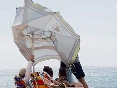 Umbrella in the wind (piranhabros) Tags: bigbeach maui hawaii umbrella people wind gale