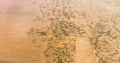 Flying over Afghanistan III (Aicbon) Tags: verde afghanistan afganistan desert town city ciudad aerea flying volando avion yellow brown desierto plano