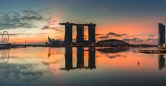 Sunrise on The Bay - Lion City (Jerry Fryer) Tags: bayside downtown city twilight sunrise marinabay singapore merlion reflections orange crepuscular rays cityscape sea seascape coast singaporeflyer