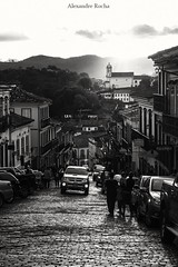 Sunset at the UNESCO Historic Town of Ouro Preto, Brazil (amrocha) Tags: 2012 ouropreto familia mg minasgerais unesco historictown patrimônio história histórico brazil brasil brasilien goldrush gold ouro corridadoouro 1800s 1800 séculoxix 18thcentury bw blackandwhite blanc noiretblanc noir schwarz schwarzweiss weiss negro negroyblanco blanco bianconero nerobianco nero bianco monochrome monocromático landscape paisagem verticallandscape vertical sunset pordosol puestadelsol coucherdesoleil southamerica américadosul americadelsur sul sur south sud sudamerika sudeste southernhemisphere bresil amériquedusud amérique dor brésil monochromatic monocromatique amrocha