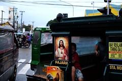Hiding behind Jesus (Fergus Brooks) Tags: jesus palawan philippines filipino kid puerto princesa travel backpacking unseen asia earth hiding