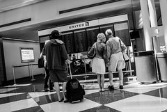 Looking for the gate (.Chris Lee) Tags: travel people blackandwhite bw white chicago black travelling monochrome modern bag walking tile person prime airport movement nikon looking board united crowd flight wide wideangle cx monochromatic terminal ohare monitor human transportation transit airline monitors bags persons grayscale nikkor airlines suitcase departure departures checkerboard flights v1 chicagoohare travelers humans crowded suitcases greyscale 10mm primelens nikon1 1nikkor nikoncx nikonv1 1nikkor30110mm