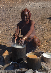 Himba Woman Cooking, Epupa, Namibia (Eric Lafforgue) Tags: africa shirtless cooking vertical outdoors photography day breast fulllength tribal bracelet afrika tradition tribe namibia foodanddrink oneperson kaokoveld himba epupa southernafrica namibie damaraland realpeople colorimage onewomanonly cunene namibe colorpicture namibi namiibia kuneneregion colourimage africanethnicity 1people himbatribe ethnicgroup ovahimba himbapeople nomadicpeople colourpicture     namibya namibio    herdingpeople namibia9202