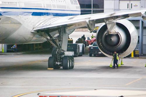 airliners international july notidealimages airport airplane fullsize exterior multiengine jet air china boeing 777 777300 arriving lax parked starboard engine main landing gear fuselage through walkway window southern california socal aircraft plane outdoor vehicle