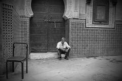 scenes of everyday life (Fes medina) (Fleccki) Tags: life street city portrait people urban blackandwhite bw monochrome real strada sitting fuji candid streetphotography bn morocco fez sit marocco medina fujifilm seated ritratto lun fes blackdiamond xe1 lunaphoto urbanarte fesmedina lunagallery streetpassionaward fujixseries fujinonxf35mm fujifilmxe1 fujixe1