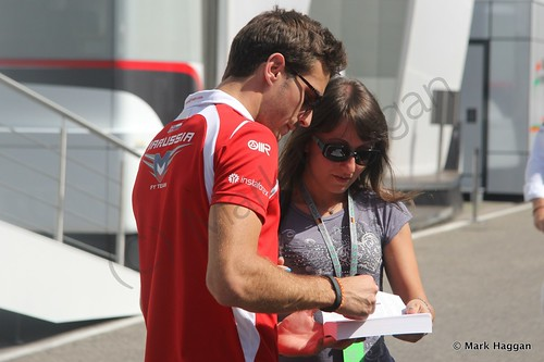 Jules Bianchi signs an autograph after qualifying for the 2014 German Grand Prix