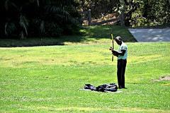 Berimbau Player (Pedestrian Photographer) Tags: california park musician music grass los photographer play angeles percussion sunday lawn may pedestrian charles southern socal single bow instrument berimbau string noon griffith ribbet 2014 dsc5594 pedestrianphotographer dsc5594b