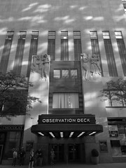 Rockerfeller Morning (cadburyon) Tags: nyc blackandwhite bw newyork architecture morninglight entrance artdeco basrelief rockfellerplaza