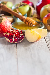 Pomegranate, apples and honey background (Speleolog) Tags: new red stilllife food holiday green apple fruit feast season table dessert cuisine wooden yummy healthy symbol sweet background space traditional faith year religion culture pomegranate tasty plate newyear celebration delicious honey slice jewish stick apples judaism copyspace tradition hebrew custom jam copy rosh symbolic hashanah roshhashana ingredient hashana judaic