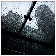 Under Glass (street level) Tags: nyc newyorkcity travel urban abstract building art glass rain skyscraper manhattan officebuilding gothamist iphone iphoneography hipstamatic