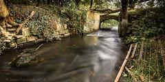 Culvert (Stuart Feurtado) Tags: longexposure bridge water wall river nikon gate stream buckinghamshire le bucks oxfordshire oxon thame d600 longcrendon