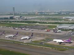 Bangkok International Airport (stardex) Tags: building architecture plane thailand airport bangkok terminal aeroplane thai airbus boeing bkk tg controltower thaiairways b777 suvarnabhumiinternationalairport stardex
