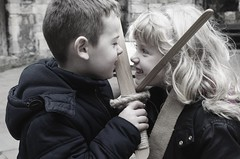 The sword fight (ETERNAL WAVES) Tags: cute children fun fight sweet battle angry innocence sword imagination