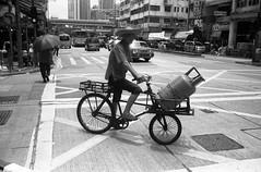 (David Davidoff) Tags: life street city people urban umbrella blackwhite gas delivery analogue leicam3 chinabike rolleisuperpan200
