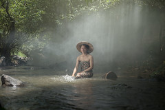 Girl Cooling (Sutipond Somnam) Tags: summer woman lake hot wet water girl beautiful beauty relax thailand outdoors cool pond women stream warm legs lakes relaxing warmth suit bikini heat suntan streams bathing relaxation laos ponds cooling