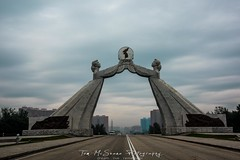 Reunification Arch in Pyongyang, North Korea, DPRK (tommcshanephotography) Tags: adventure asia communism dprk democraticpeoplesrepublicofkorea expedition exploring kimilsung kimjungil kimjungun northkorea pyongyang revolution secretcompass travel trekking