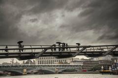 London Rain (Tony Shertila) Tags: 20150529095952 cathedralsward england gbr geo:lat=5150840524 geo:lon=009824395 geotagged puddledock unitedkingdom weather day rain sky millenium thames river walking umbrela