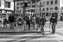 dope (Super G) Tags: sanfrancisco streetphotography people woman man walking tattoo crosswalk nikon290 california hat purse bus wires marketst texting skateboard