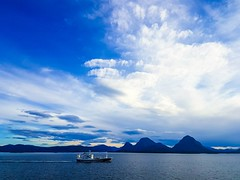 Early Morning Fishermen (MoonDog (Life is Beautiful)) Tags: sea boat coastline coast sky blue clouds morning