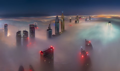 STRAWBERRIES AND CREAM (Titanium007) Tags: dubai fog sky clouds skyline skyscrapers skyscraper building town city cityscape uae colours lights light citylights