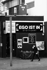 Ego Is In (Isengardt) Tags: ego club bar kneipe disco haus house fassade plakat poster trinken kaffee coffee drink lampe lamp strasenlaterne composition komposition black white schwarz weiss monochrome monochrom laufen walking strase street stuttgart badenwürttemberg deutschland germany europe europa olympus omd em1 1250mm frau woman