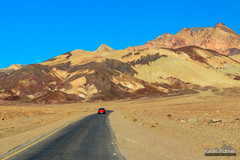 Artist's Drive (kevin-palmer) Tags: deathvalley deathvalleynationalpark nationalpark road artistsdrive red car blackmountains colorful november fall autumn clear sunny blue sky tamron2470mmf28 nikond750