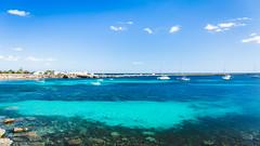 Patches of blue (Nicola Pezzoli) Tags: favignana sicilia sicily island egadi summer sea water colors nature canon tourism patches blue boat sky