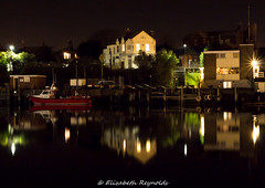 Day 334, 2016, a photo a day. (lizzieisdizzy) Tags: howiemarsh outside nighttime river boats reflection buildin buildings pub house houses light lights lighting car cars carpark park fishingboat port lamp lamps streetlamps billboards quay quayside headings windows doors reflections