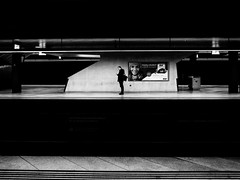 lonely is the night (matthias hämmerly) Tags: matthias hämmerly haemmerly switzerland world street photography shoot black white bw candid going collecting story faces journalism real honest moments decisive moment creative lens scene strassenfotografie frame man ricoh gr gr2 2 bahnhof hb station train lonely alone waiting warten