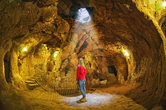 (marozn) Tags: turkey avanos cappadocia derinkuyu cave underground catacomb interior ancient stone cemetery geological travel archeology rocky attraction history formation stalactite old tourist mineral tourism hole geology town rock humid sightseeing moist city ruin inside antique cavern village fisheye view light panorama one alone person people girl woman sitting rest look standing