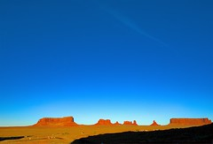 Late Afternoon Look at Monument Valley's Icons (Herculeus.) Tags: 2016 bouldersstonerocks butte clouds country day erosion fall fromgouldings landscape landscapes mesa monumentvalley nativeamerican navaho navahonation oct outdoor rockoutcrop shadows stratusclouds6kfeet ut vaportrails sky 5photosaday