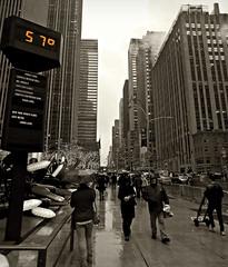 57 & Rain (Robert S. Photography) Tags: rainyday shower autumn midtown rockefellercenter buildings temperature rain people umbrellas city walking sepia nyc manhattan nikon coolpix l340 iso80 november 2016 selectivecolor