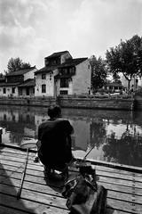 Qingmingqiao () Tags: china street leica travel people blackandwhite film architecture lens blackwhite cityscape wuxi snapshot documentary rangefinder 35mmfilm leicam7 reportage streetshot m7 superwideangle carlzeiss fomapan100 zm fomapan rangfinder  nikonsupercoolscan9000ed flickraward biogont2825 qingmingqiao