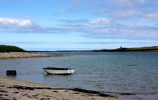 boat in a sandy bay