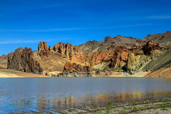 Lake Owyhee (http://fineartamerica.com/profiles/robert-bales.ht) Tags: statepark road blue red wild cliff mountain lake reflection dusty nature water rock stone clouds oregon rural river walking outdoors volcano lava photo flickr solitude desert hiking fineart towers scenic bluesky canyon sage reservoir spire climbing highdesert leslie outback remote states geology wilderness phallic eastern volcanic rockformations haybales gulch blm rockformation easternoregon owyhee lesliegulch volcanicformations robertbales lesliegulchstatepark