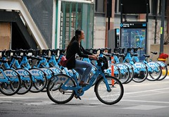 Going for a downtown ride. (Cragin Spring) Tags: city people urban woman chicago bicycle illinois downtown unitedstates chitown il riding chicagoillinois chicagoil windycity bikerentals divvy