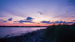 Shining Clouds (Sren Schaper) Tags: sunset sea summer vacation panorama sun lighthouse holiday seascape green water landscape nikon meer wasser sonnenuntergang sweden stones sommer pano schweden rosa sigma baltic lila steine filter nd gras sverige scandinavia landschaft weite ostsee leuchtturm kalmar land borgholm l