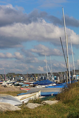 Huts and boats: 12.10.16. (VolVal) Tags: dorset bournemouth hengistburyhead sandspit huts boats masts sky october
