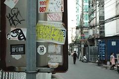 Rap is Now (Thong Lo Bangkok) (jcbkk1956) Tags: thonglo street bangkok stickers streetfurniture nikon d70s nikkor 1870mmf3545 man walking worldtrekker