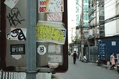 Rap is Now (Thong Lo Bangkok) (jcbkk1956) Tags: thonglo street bangkok stickers streetfurniture nikon d70s nikkor 1870mmf3545 man walking worldtrekker