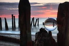 SEE THE WORLD YOUR WAY (car 67) Tags: yorkshire sunrise spurnpoint groynes sea northsea glass ball glassball crystalball future tide