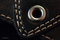 Double Stitching (VenturaMermaid) Tags: macromondays stitch macro photo contrast doublestitch leather stitching 100mm tokina canoneos rivet f56 composition abstract