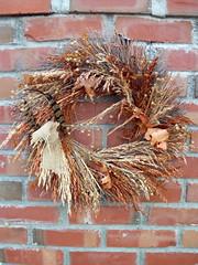 Autumn Wreath. (dccradio) Tags: lumberton nc northcarolina robesoncounty outdoors outside nature autumn wreath brick decoration ornament