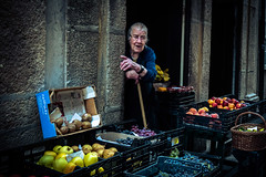 For meat, go that way !! (John Bastoen) Tags: straatfotografie streetphotography street color fruit old lady guimaraes portugal