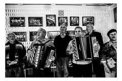 The Old Chorus (Roman Lunin) Tags: easternukraine ukraine chorus elderly old people aged accordion backtoussr ussr soviet blackwhite blackwhitephoto blackwhitephotography black white monochrome music friends
