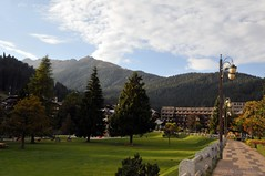 Park in Madonna di Compaglio (Vee living life to the full) Tags: madonnadicampilio skiresort mountains shopping tourists nikond300 italy trentino hotels park trees flowers cafes pavement outside forests aboriculture